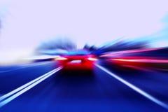 速度在街道的行动汽车 库存图片