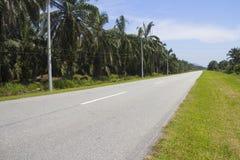 速度推进旅途的农村路高速公路 免版税图库摄影