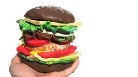 造型黏土乳酪和猪肉用红萝卜汉堡黑暗的巧克力莒 图库摄影