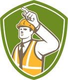 建造者指向盾的建筑工人减速火箭 库存图片