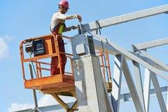 建造者建造场所的水车工工作者 库存照片