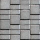 仿造自然石头的灰色铺路板 免版税库存图片