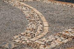 道路包括石头 免版税库存照片