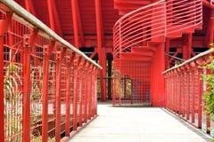 道路和旋转的梯子在红色 库存图片