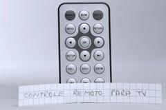 遥控在葡萄牙语语言的英国和controle remoto巴拉电视 图库摄影