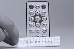 遥控用英语和Fernbedienung德国词 免版税库存照片