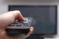 遥控的电视 免版税库存照片