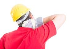 遭受后面脖子痛的建设者 库存照片