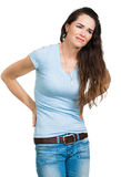 遭受背部疼痛的妇女 免版税图库摄影