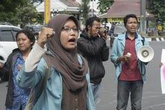 遮掩反对腐败的男女共学抗议在独奏城市 免版税图库摄影
