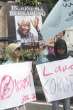 遮掩反对腐败的男女共学抗议在独奏城市 免版税库存照片