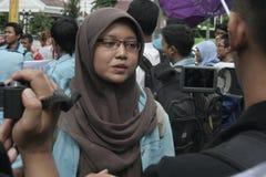 遮掩反对腐败的男女共学抗议在独奏城市 库存照片