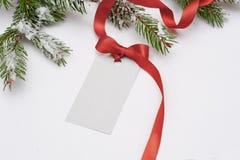 邀请圣诞节的卡片销售与一把红色弓 库存照片