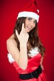 邀请女孩的帽子圣诞老人 免版税库存照片