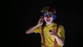 邪恶的可怕小丑拨电话号码惊吓您 股票视频