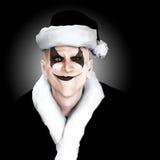 邪恶的小丑圣诞老人 免版税库存照片