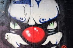 邪恶的小丑的街道画 库存图片