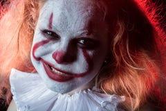 邪恶的小丑表面 库存照片