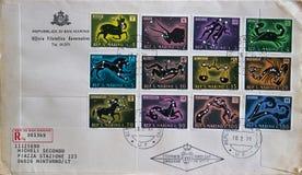 邮票圣马力诺(意大利)系列的第一天盖子代表黄道带的签字 免版税库存图片