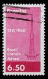 邮票在有巴西利亚抽象符号的图象的巴西打印纪念建立巴西` s资本 库存图片