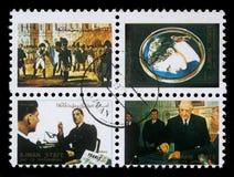 邮票的汇集在显示图片的著名男人和妇女的阿吉曼打印了 库存图片
