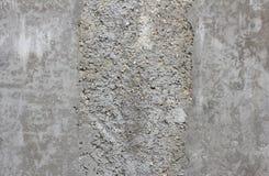 部分地涂灰泥的一部分的混凝土墙,纹理 库存照片