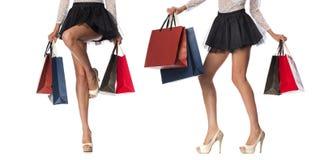 部分身体,美好的女性苗条腿 举行pa的性感的女孩 免版税库存照片