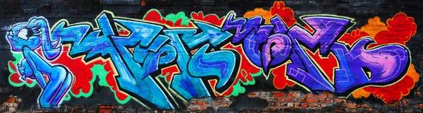 都市惊人的五颜六色的街道画 免版税库存照片