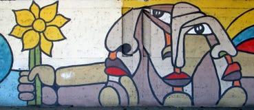 都市的艺术 花和多面孔 免版税库存照片