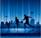 都市背景的足球 库存图片