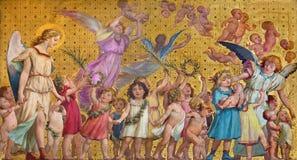都灵,意大利- 2017年3月15日:圣洁清白的人孩子符号壁画有天使的在教会切萨di圣Dalmazzo里 免版税图库摄影