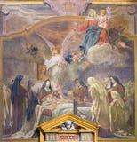 都灵,意大利- 2017年3月13日:壁画圣Theresia死亡在教会基耶萨di圣诞老人特里萨里Rodolfo Morgari 库存照片
