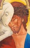都灵-耶稣绘画作为上帝羊羔临时房屋的旁边法坛在教会基耶萨di圣弗朗切斯科da Paola里 免版税图库摄影
