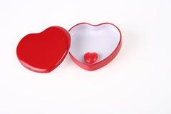 配件箱在红色里面的糖果重点 免版税库存图片