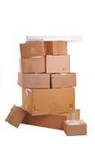 配件箱粗心大意地堆积了顶层 免版税库存照片