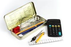 配件箱计算器铅笔 免版税库存图片