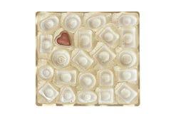 配件箱candie查出的巧克力金子 免版税库存照片