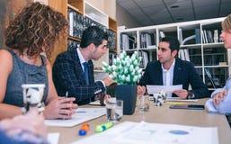 配合在关于总部的一个业务会议 图库摄影