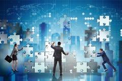 配合的企业概念与难题的编结 库存照片