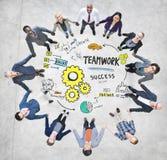 配合队合作商人团结概念 免版税库存图片