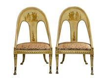 配对古色古香的葡萄酒在w隔绝的被绘的埃及样式椅子 免版税库存图片