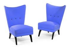 配对在白色隔绝的明亮的浅灰蓝色软的椅子 库存照片