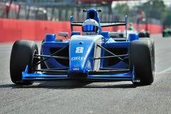 配方3在蒙扎跑道的赛车 免版税图库摄影