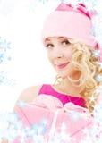 配件箱快乐的礼品女孩辅助工圣诞老人 图库摄影