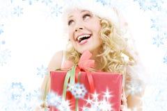 配件箱快乐的礼品女孩辅助工圣诞老人 库存图片