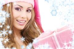 配件箱快乐的礼品女孩辅助工圣诞老人 免版税图库摄影