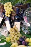 酒神-酒和葡萄 免版税库存照片