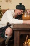 酒醉苏格兰男子 库存照片