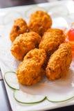 酥脆油煎的水多的牡蛎鸡块 免版税库存图片