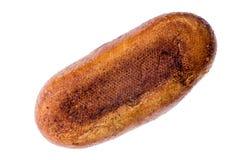 酸面团一个被环绕的大面包的下面  图库摄影